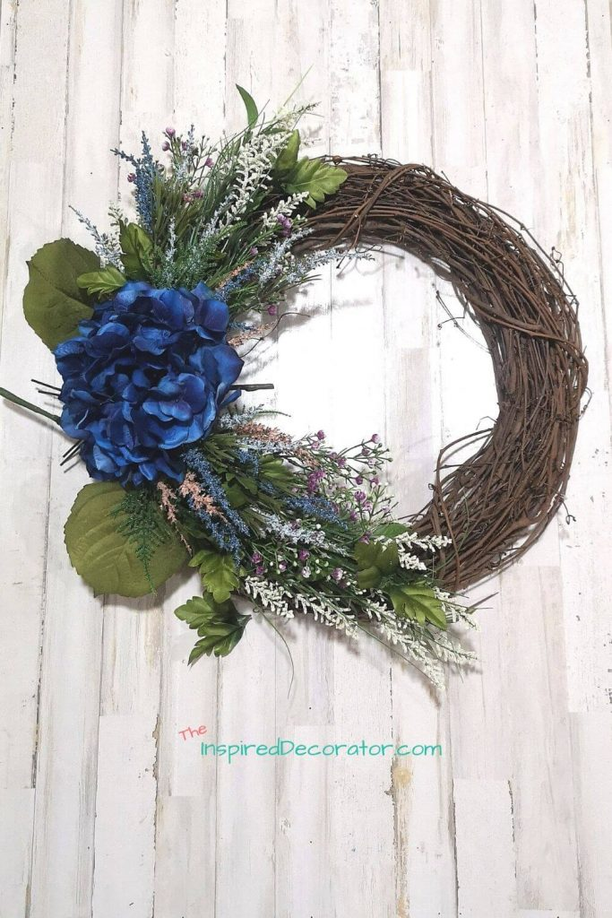 Whenever possible, it's a good idea to do a dry run, or a unsecured fitting of what you want your wreath to look like. Take a picture too so you can reference it as you work.- the Inspired Decorator
