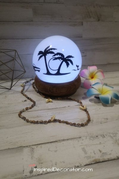 Make a DIY Night Light using an old light fixture. Upcycling materials and repurposing them for new home decor is great for the environment. Use your creativity and this tutorial for your own fun lamp. - the Inspired Decorator