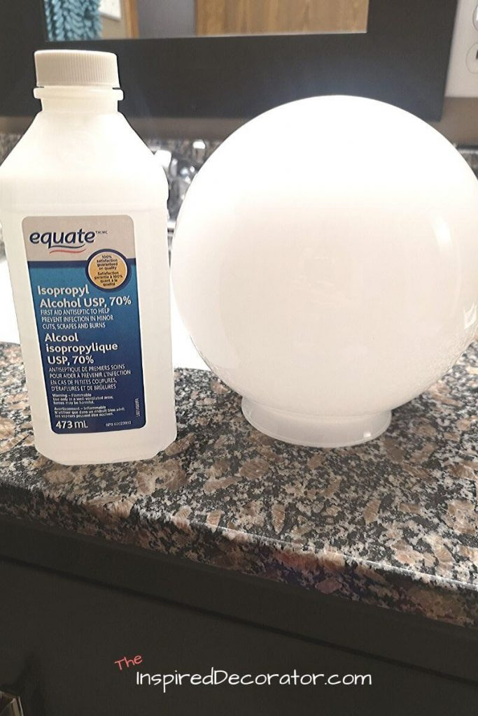 Rubbing alcohol can be used to get even more dirt off of your galss lamp shade before adding any vinyl decals or stickers. - the Inspired Decorator