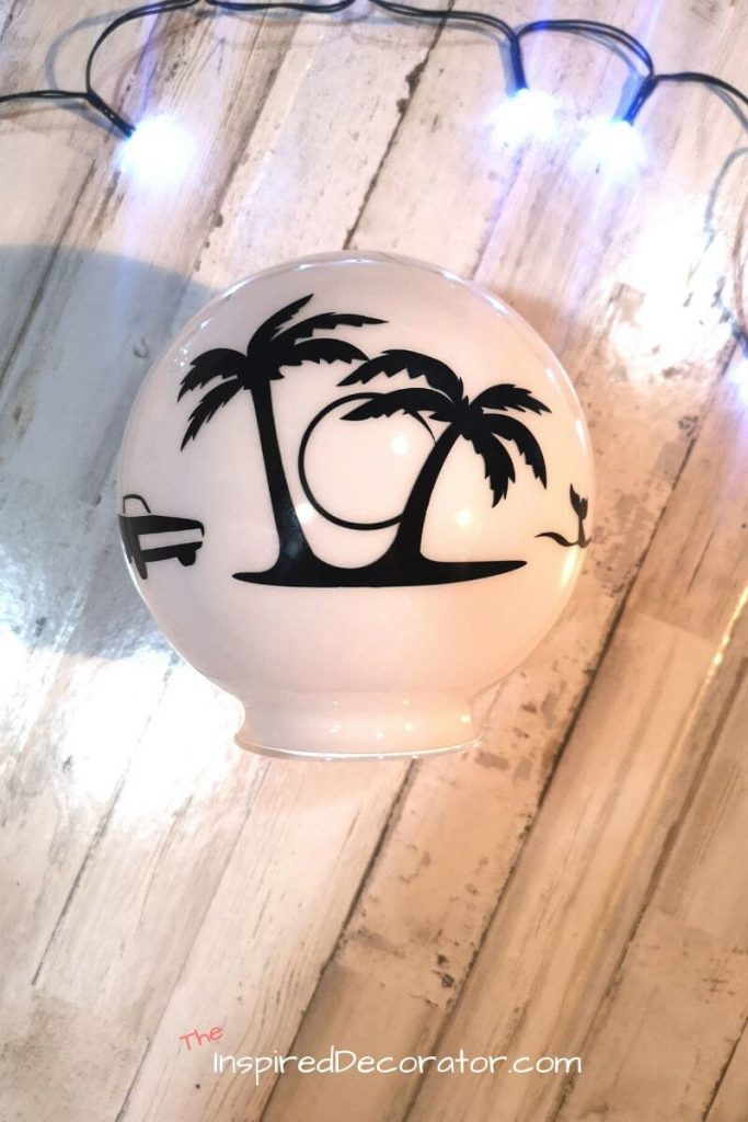 The lamp shade for the diy night light is ready! A car, palm trees, and whale vinyl decal are fully attached and ready to glow. - the Inspired Decorator