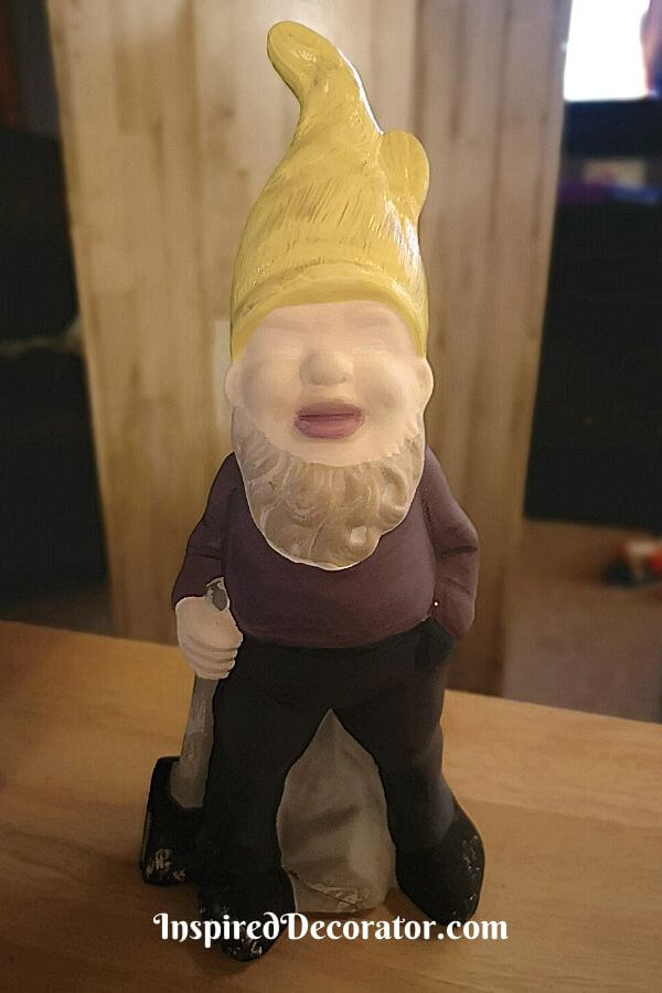 The Sledgehammer Garden Gnome was first painted in the solid colors of his purple shirt, navy pants, and yellow cap before details were added.