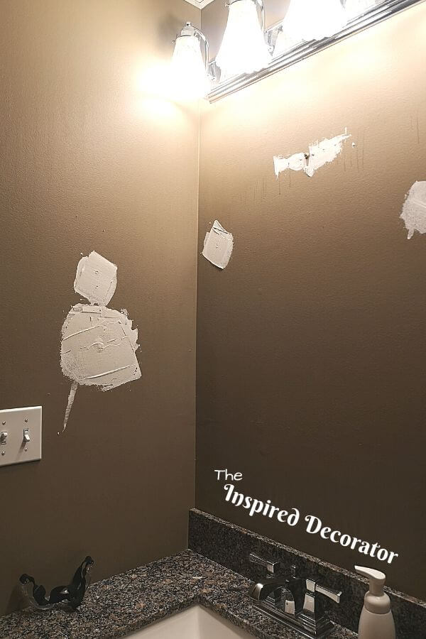 Patch and fill holes in your walls, then sand smooth for a better finish for painting on. - the Inspired Decorator