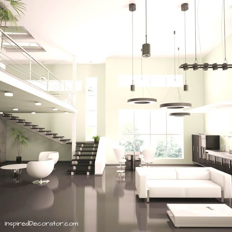 Contemporary Style uses what is most popular today in a cozy and functional way. This room has neutral tones of greys and whites, functional lighting, and curved furniture to offset the hard lines and materials.
