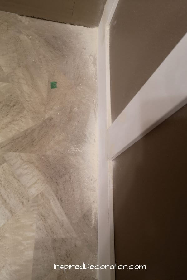 Lots of sawdust on the floor from sanding this faux diy wainscoting wall.