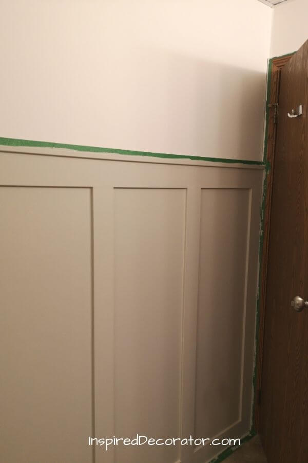 A look at the other end of the diy wainscoting wall where it meets the door frame.