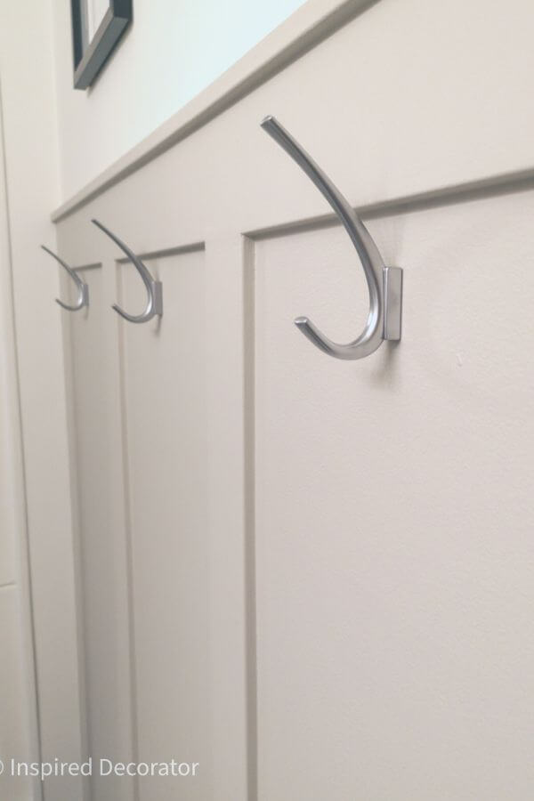 Curved, silver towel hooks have a unique J shape to hold multiple towels or clothing items.- the Inspired Decorator