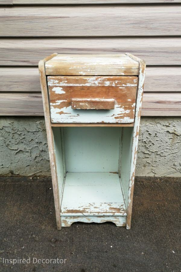 A vintage cabinet that is beautrifully weathered with chippy paint.