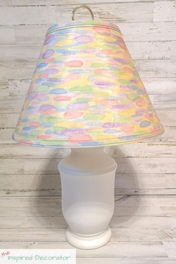 The rainbow watercolour DIY lamp makeover adds a fun detail to any room. The white lamp base doesn't takes away from the brightly painted lampshade.