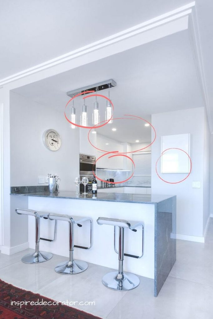 This kitchen area has multiple lighting sources layered into the one area.