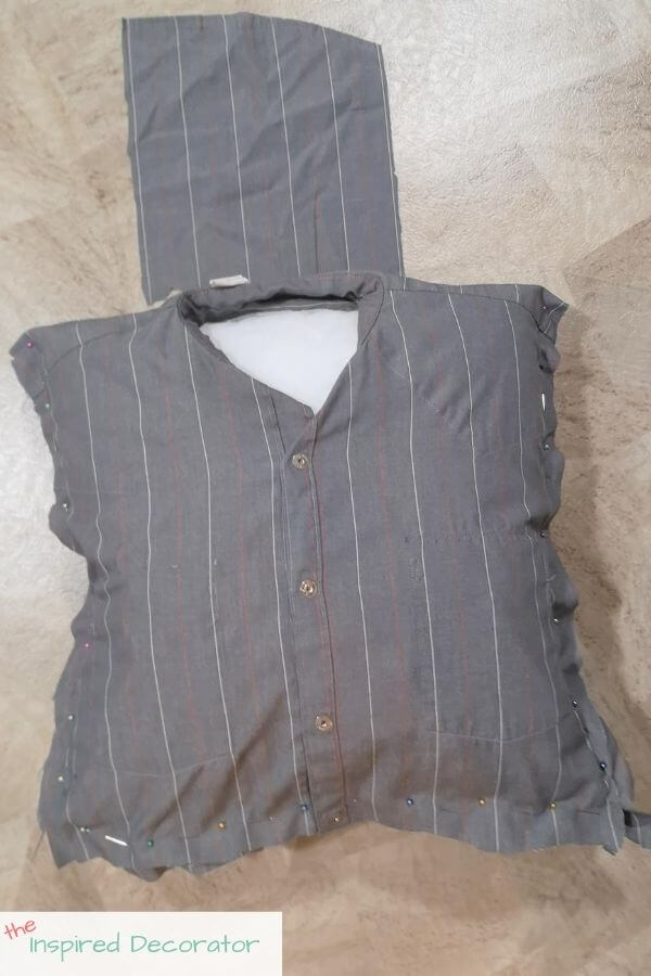 Use a large piece of the scrap fabric to create a cover for the neck area of the shirt and hide the pillow insert.