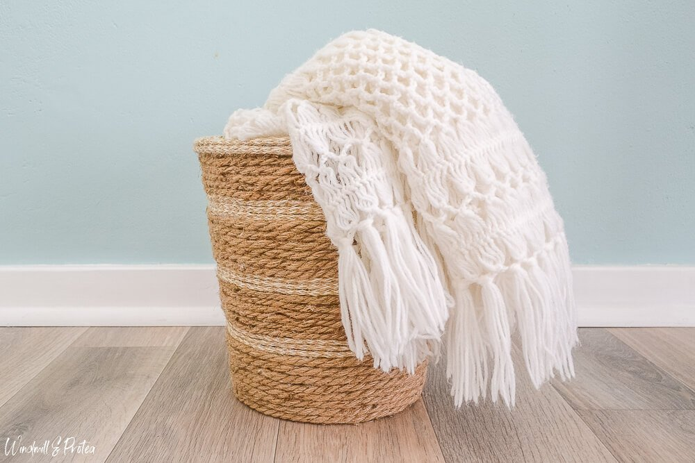 DIY your own woven rope basket made from an old pail and jute rope.