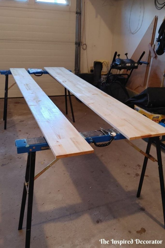 """Laminated Pine Boards are getting a clear coat on them. They both started out as 12""""x 96"""", one was cut down to 8""""x 96"""". They will be anchored together to for a 20""""  96"""" countertop for the new workstation."""