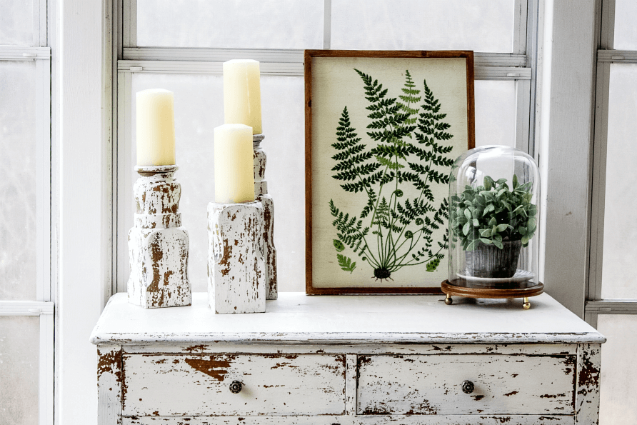 Create these beautiful DIY chippy candlesticks made from an old bed post.