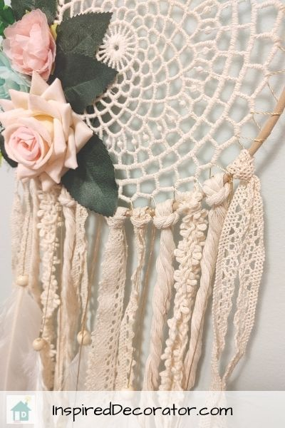 A sweet dreamcatcher was made using ribbon ends and a doily.