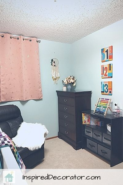 In this view of the girls nursery room reveal, you can see the more decorative corner.