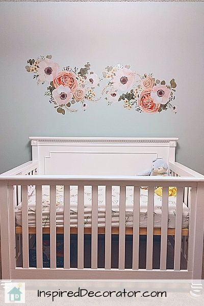 Floral peel and stick wall decals were used above the crib. This is a safe way to add some art above a crib without the risk of anything falling into the crib.