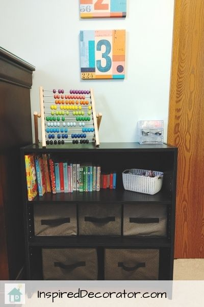 An adjustible bookshelf from Walmart fits perfectly beside the dresser for extra storage.
