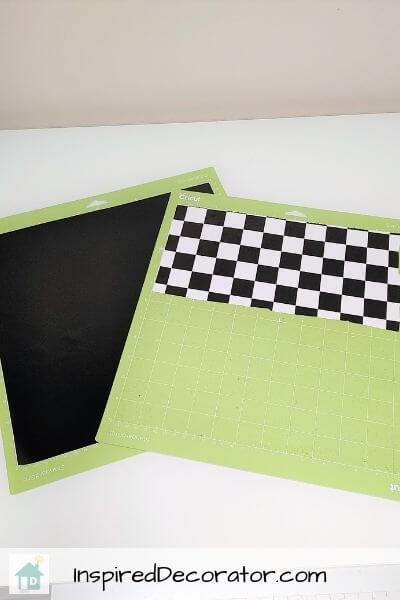 Crafting vinyl is cut to size on Cricut cutting mats and ready to be designed into race car flags.