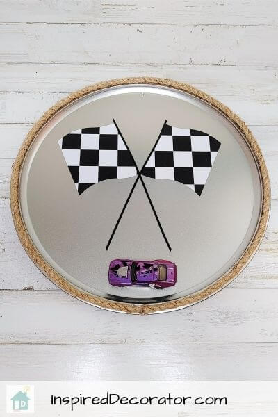 A decorative DIY metal race car sign to hang up in a race car themed bedroom.