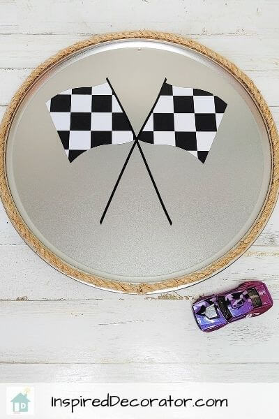 A decorative DIY metal wall sign designed with Racing Flags for a race car themed boys bedroom.